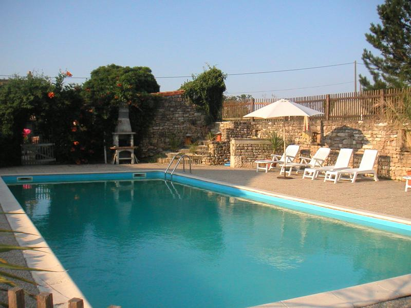 Large heated swimming pool and terrace