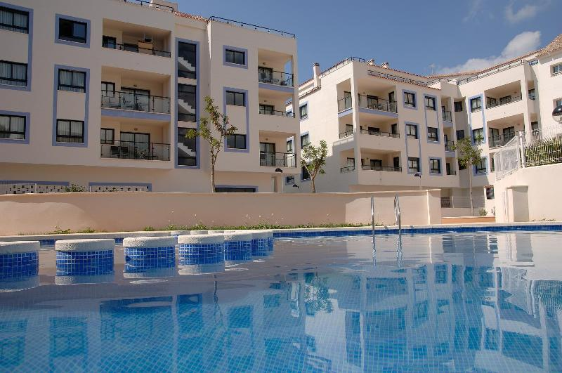 The Swimming Pool and Apartments