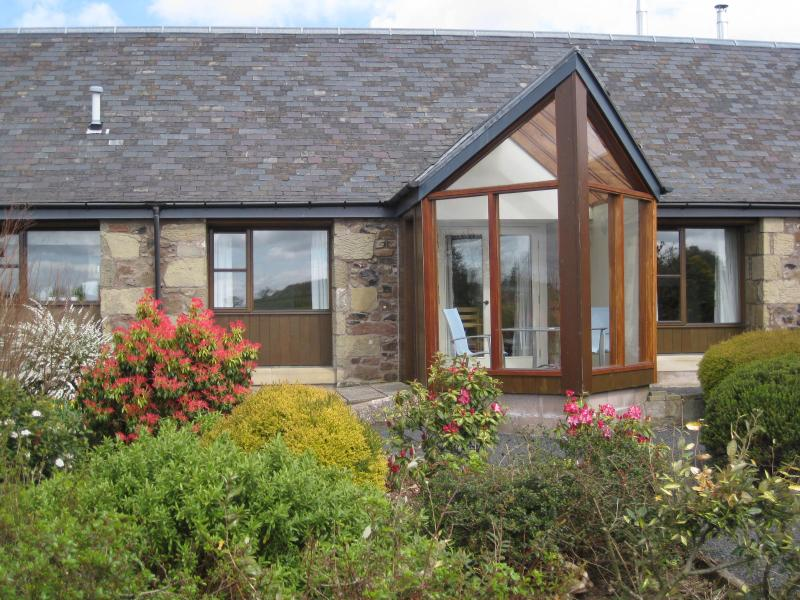 Mungo's Well has a private south facing conservatory with views over cottage garden to Cheviot