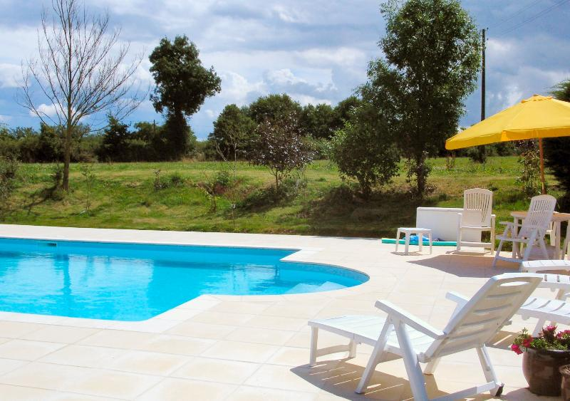 Swimming pool with loungers - perfect for summer sun