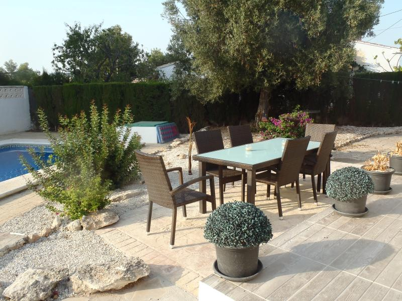 Private and secluded area at the rear of the villa, with a 8x4m pool, large sofa area and table.