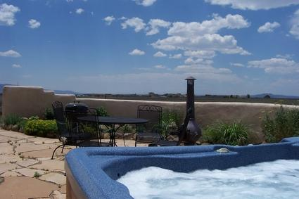 view from hot tub overlooking vast vacant land behind house