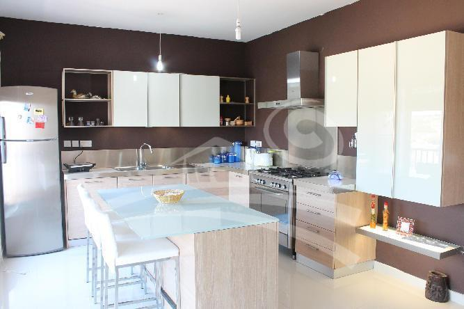 Fully equipped kitchen with large center island and many appliances