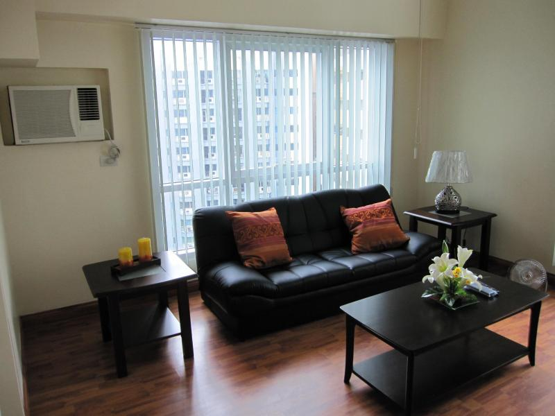 Living Room with Convertible Sofa Bed - Urban Loft Condo w/ Parking in Ortigas CBD - Pasig - rentals