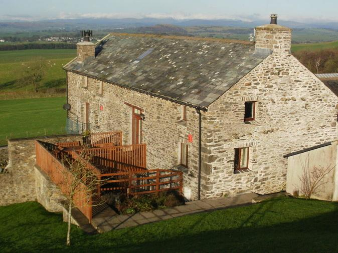 A stylishly converted barn with stunning views to the South and West. Rated 4 star Gold