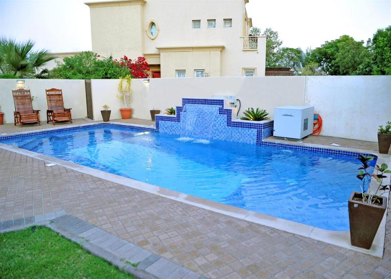 Large heated swimming pool with water fountain