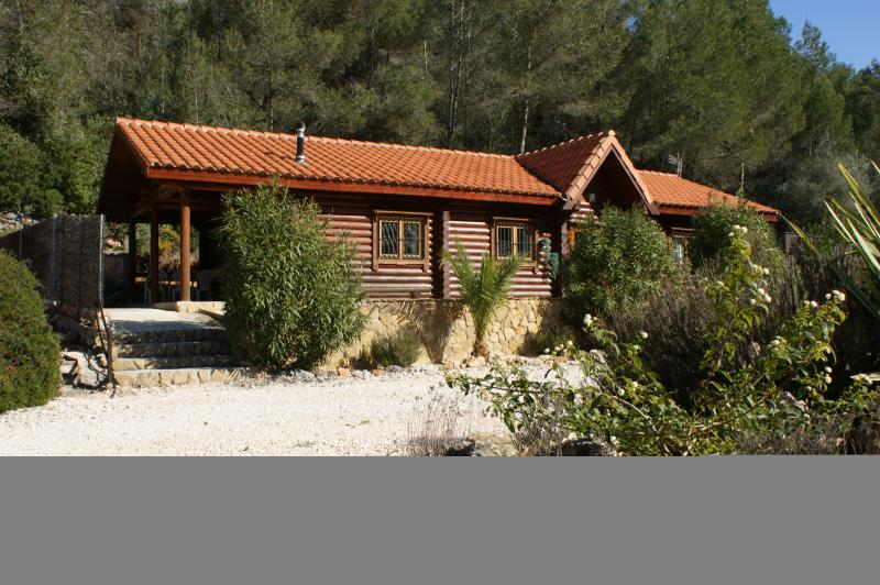 front view of cabin, Rustic hand built off round logs