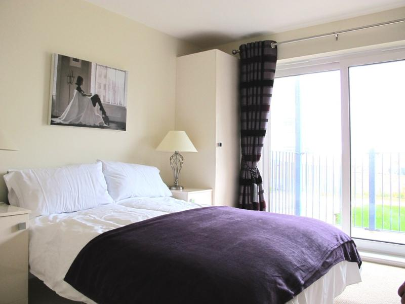 Master Bedroom with doors leading out to Private Balcony with Sea Views