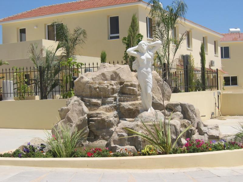 The Helen of Troy statue, near the secure gated entrance, with house in the background.