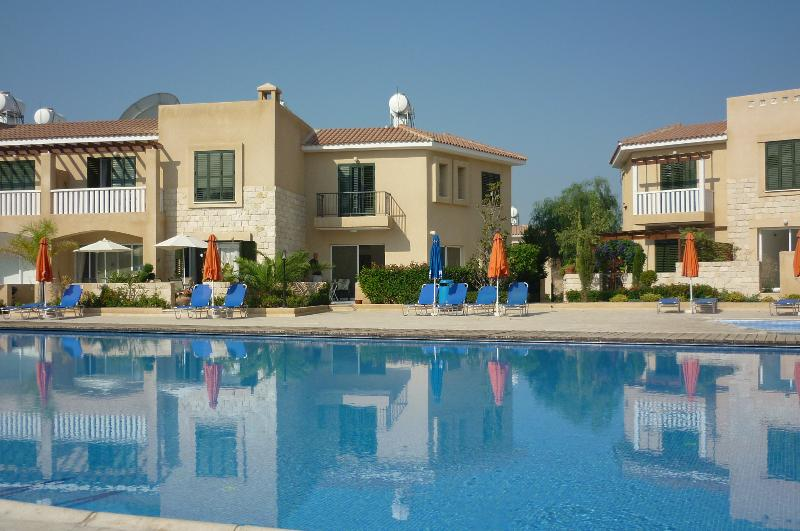 The Villa has a large corner patio overlooking the pool