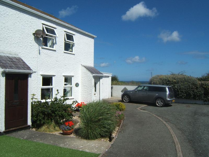 Situated at the end of the cul-de-sac, next to the field, with sea views and affording good parking