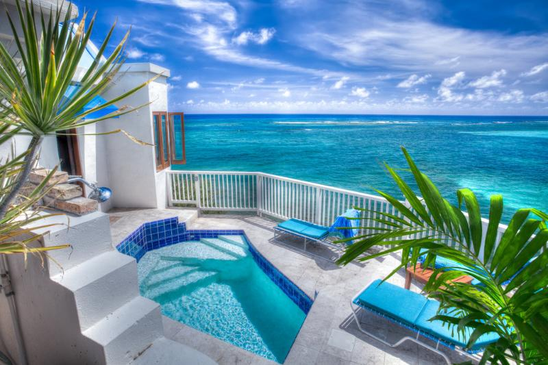 There is a plunge pool and outdoor shower adjacent to Honeymoon cottage leading to a stairway down to the beach.
