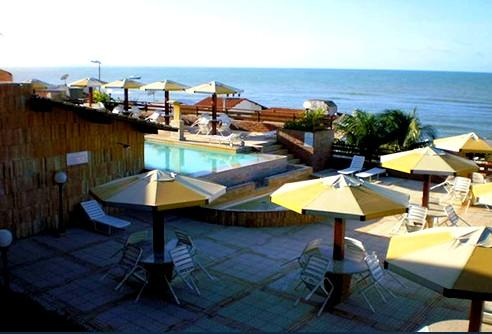View from the first floor on swimming pool and sea
