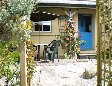 Pretty archway into Dairy Cottage's south-facing private patio garden