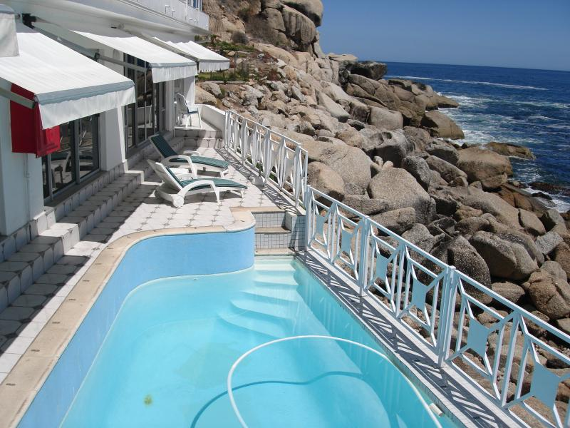 Private pool on the rocks, all rooms lead onto terrace