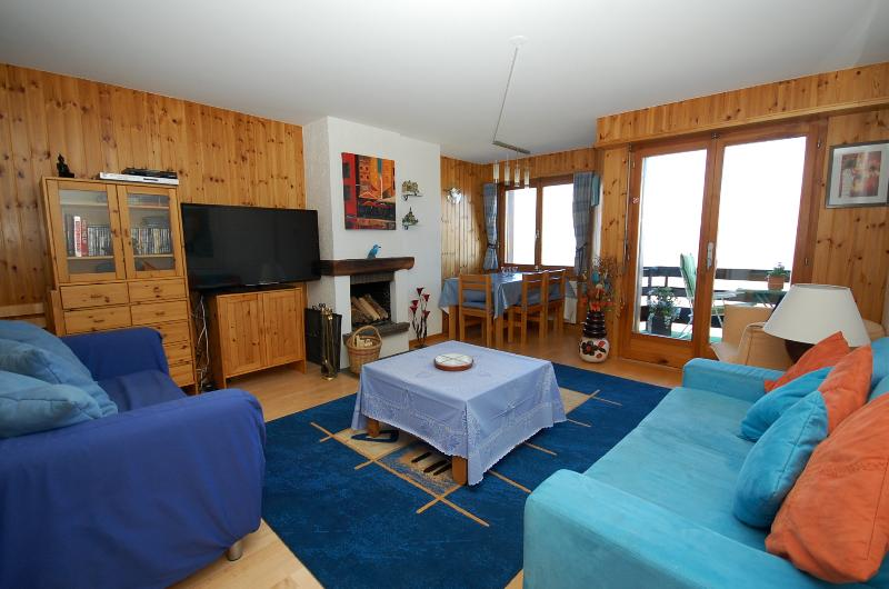 Open plan lounge area with log fire, 47'/119cm HD cable TV and WiFi, PS3; doors to balcony