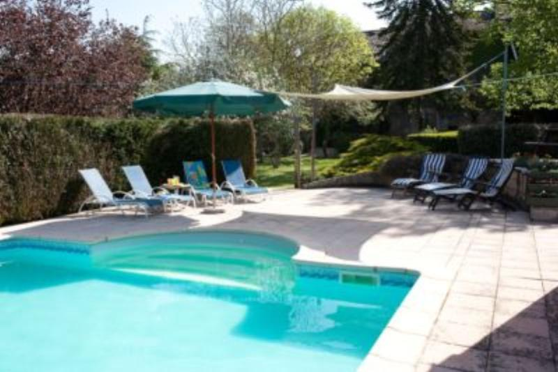 The beautiful pool privately set within the large garden.
