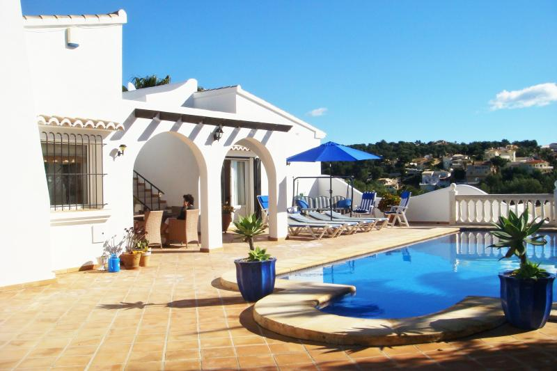 View of the property with swimming pool and sun loungers situated on the South