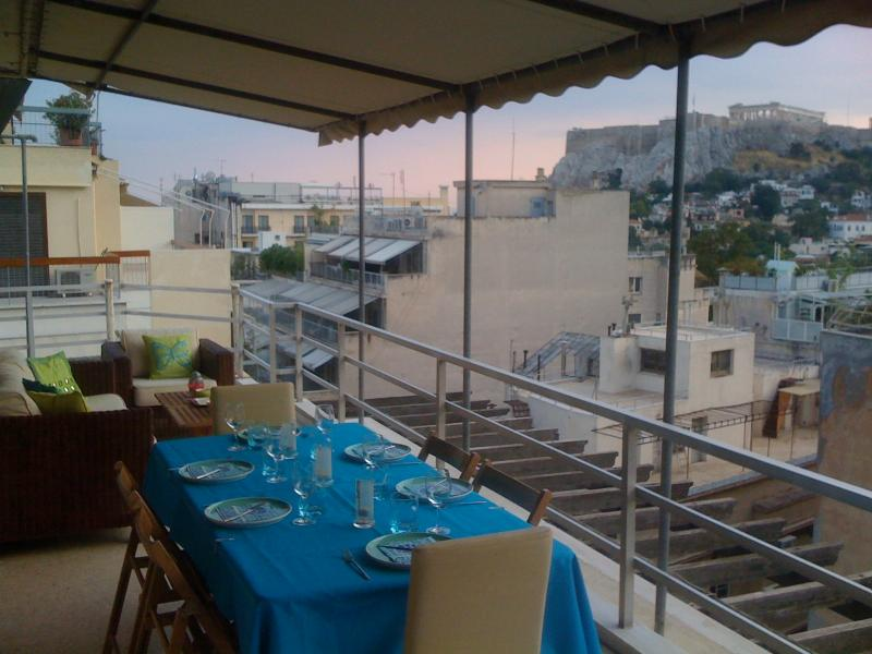 The terrace, with the Acropolis in the background