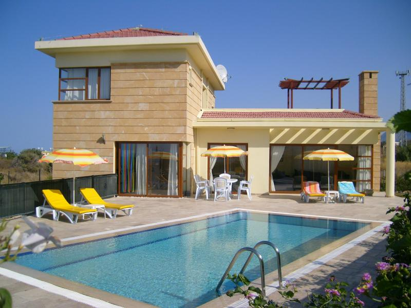 Modern Villa with Overflow Pool, extensive patio and fantastic sea and mountain views