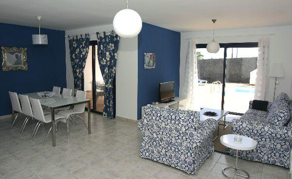 living area with patio doors leading to the pool