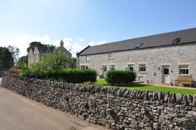 Luxury barn conversion featuring 4 cottages and adjacent to Endmoor Farmhouse. Will accommdate 22.