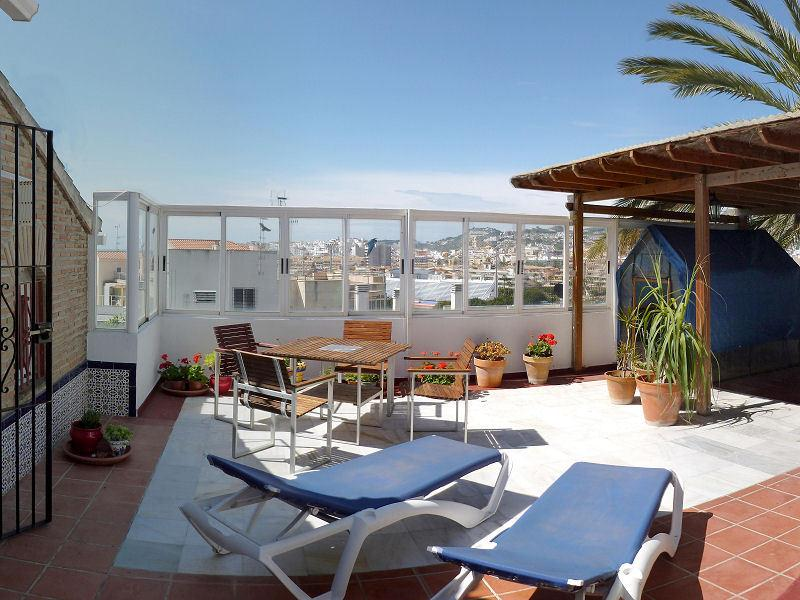 Sun terrace on the 2nd floor with views of Almuñécar and the surrounding hills