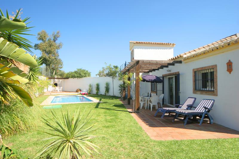 Secluded gardens and private pool