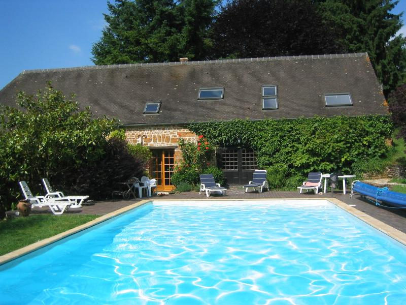 The pool and cider barn, with part of Les Roses
