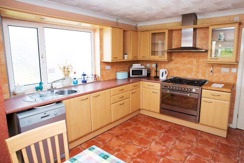 Gower Edge Kitchen with dual fuel range cooker, dishwasher, microwave and fridge freezer.