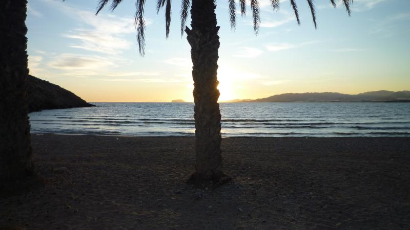 Enjoy a sunset on the heat soaked beach with feet a-dipping