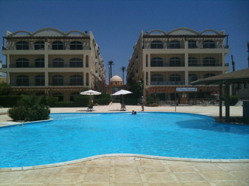 Pool and rear view of apartment/Hotel