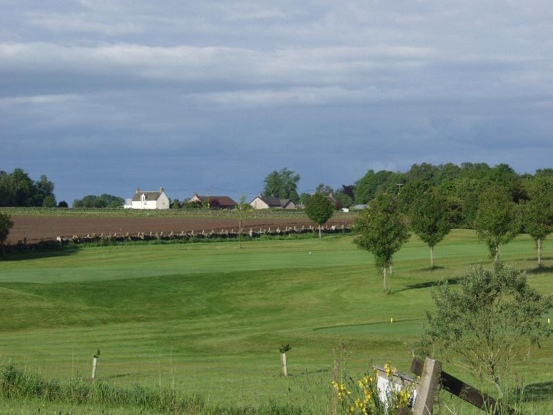 View from the Alyth Golf Club car park over the Glen Isla Golf Course to Arrochymor (3rd from left)