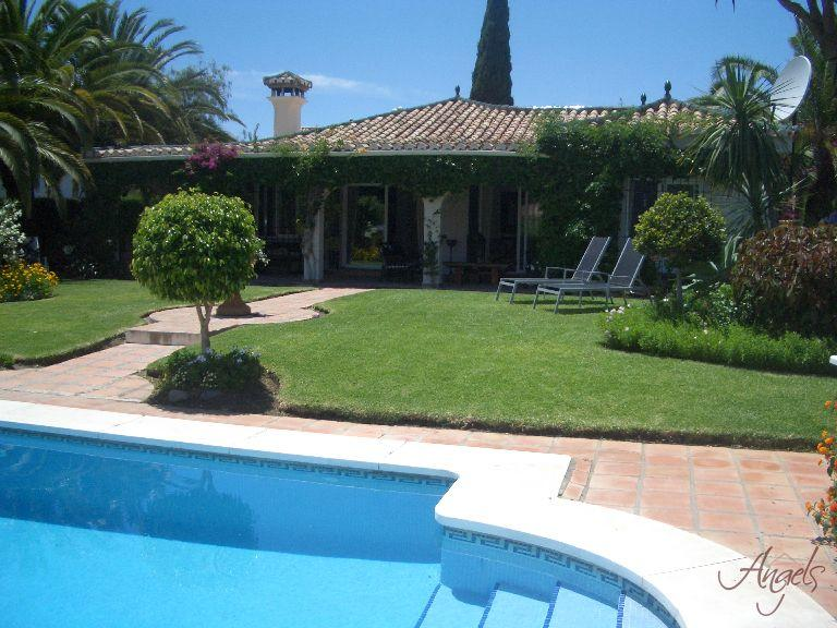 Perfectly kept garden with abundance of flowers, trees, shrubs and Lawns