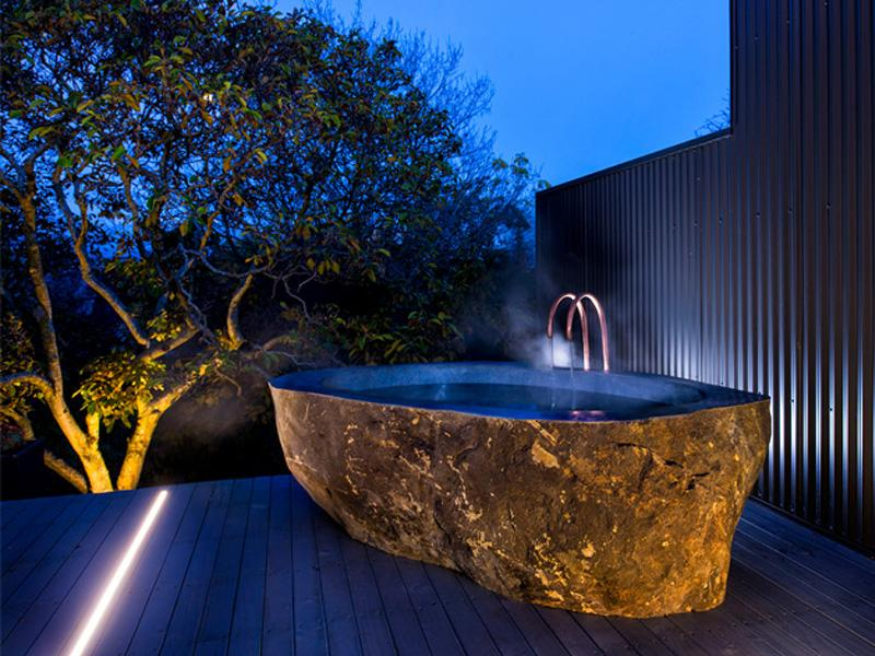Hot outdoor bath carved from volcanic stone - an amazing experience