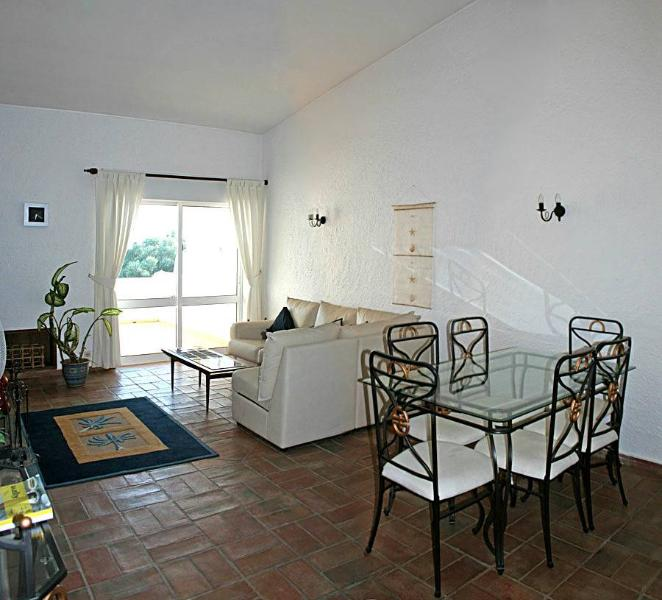Lounge/ Dining room patio doors to terrace/balcony with sunbeds, table & chairs. Separate kitche