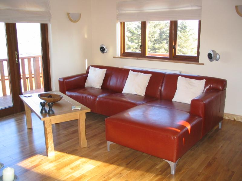 Open plan lounge with doors to decking.