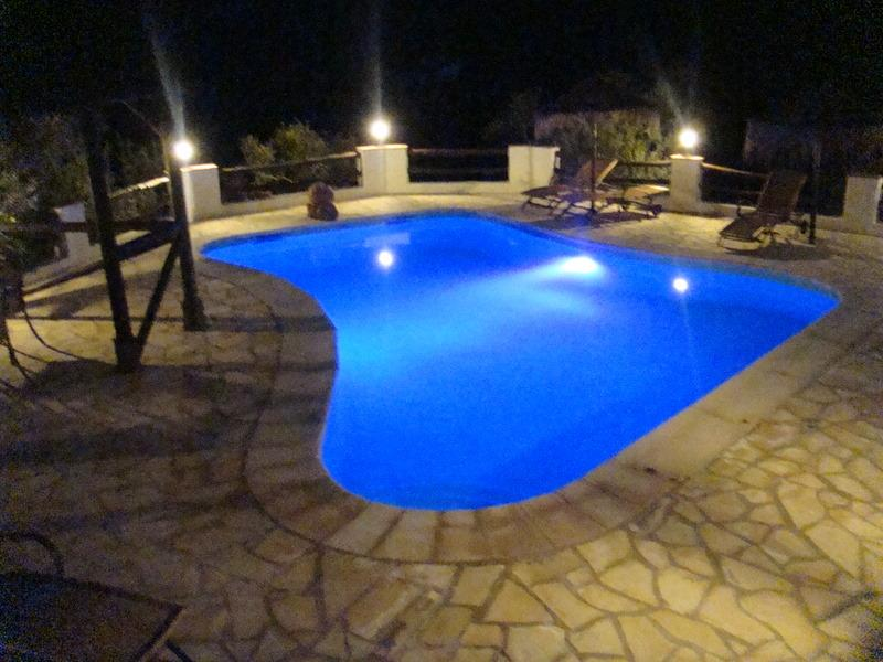 Pool at night with color changing light