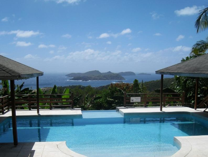 The Grand Pool Area overlooking dozens of islands including Mustique and Grenada