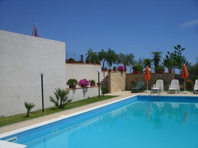 private swimming pool with sun terrace with sun loungers and parasols