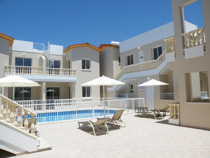 Pool Area, fully equipped with sunloungers, parasols, toilets and showers