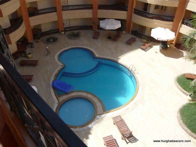 1 of 2 Communal Swimming Pools with sunbeds and parasols