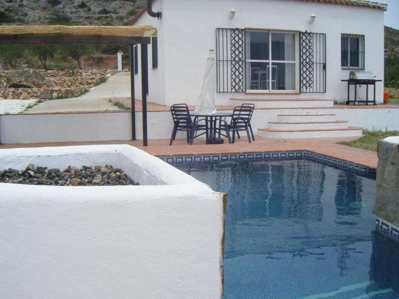Our south facing property has a shaded patio, 6m x 5m pool and large landscaped gardens
