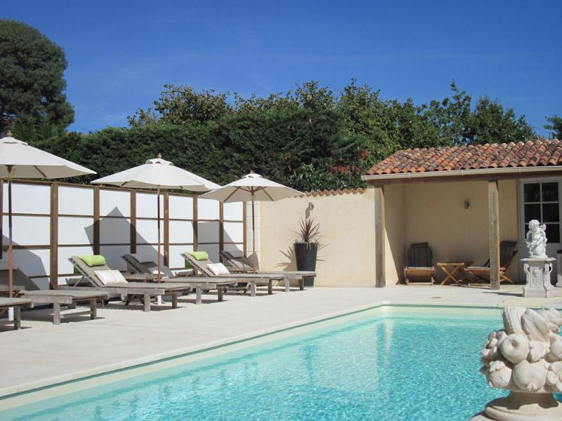 The lovely heated pool with south facing terrace, sun-loungers and cushions