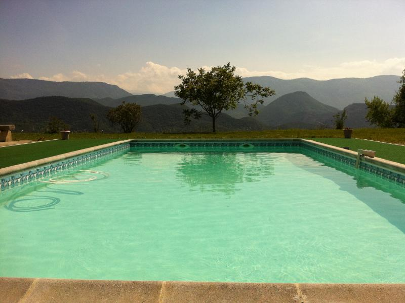 Crystal clear pool looking out onto the mountains.