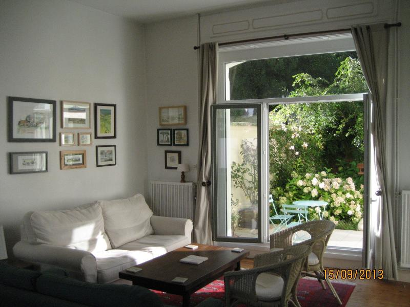The large sitting/diningroom opens onto the garden