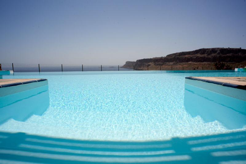 View from infinity pool to sea & cliffs of Navarone