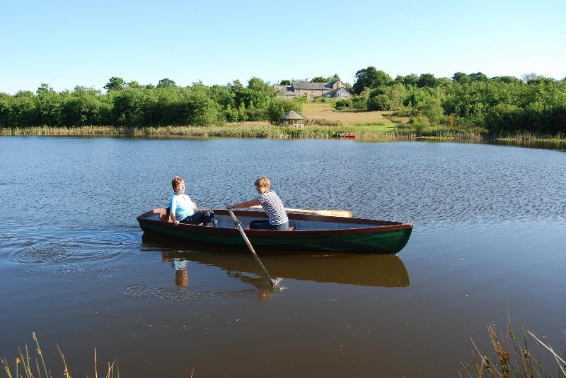 The Garden House is situated in 18 acres of stunning gardens and woodland. Fancy a row on the lake?