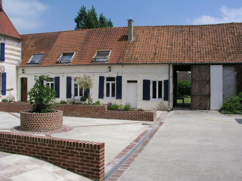 The Farmhouse with barn through to garden. The enormous private courtyard is secured by large doors