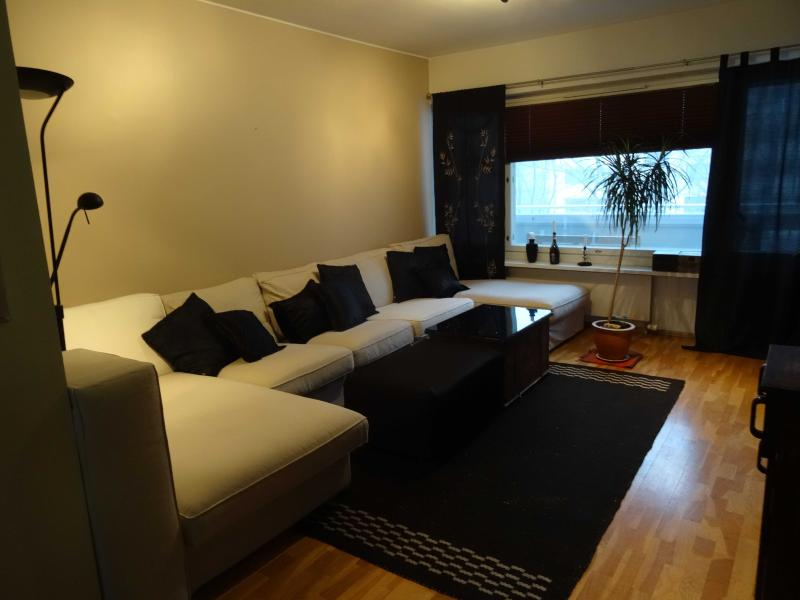 Livinroom with extra large sofa, ideal for spending time together or relaxing after a day in city.